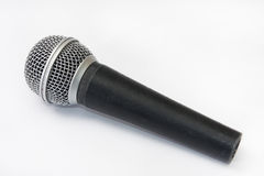 Used vocal microphone on the white background Royalty Free Stock Photo