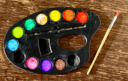 Used water-color paint box and paint brush Stock Photo