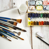 Used water-color paint-box, watercolor paper and paint brush. Royalty Free Stock Photography