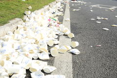 Used water paper cup after marathon running on street at Xiamen Stock Photo