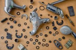 Used water taps and washers top view stock photo
