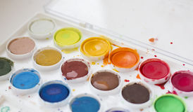 Used watercolor paint set. Used palette of multicolor watercolor paints. Extreme shallow depth of field with  blurred foreground and background Stock Photo