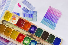Used watercolor paints palette in box, paper and acrylic brush. Glazing lesson for the beginners, artists, student, pupil. First s Royalty Free Stock Photo