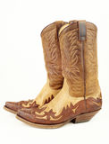 Used western boots. Used brown cowboy western boots for women isolated on white background Royalty Free Stock Photo