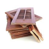 Used window shutters - recycled building materials. Used window shutters, recycled building materials, on white Stock Image