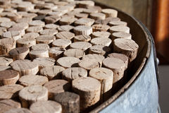 Used wine corks collection. Collection of used wine corks on the upper surface of an old barrel Royalty Free Stock Photos