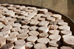 Used wine corks collection. Collection of used wine corks on the upper surface of an old barrel Royalty Free Stock Images