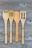 Used wooden cooking utensils on old wood Royalty Free Stock Image