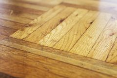 Used wooden parquet flooring up-close. Macro detail shot of wooden flooring with traces of usage Stock Images