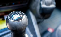 Used, worned gear shift knob close up. Shallow depth of field, copy space royalty free stock photo