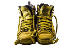 Used yellow boots. Isolated on white background Royalty Free Stock Photos