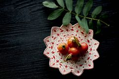 Useful antioxidant rosehip lying on a platter on a dark background.Healthy eating during deficiency Stock Photography