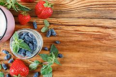 Useful berries to prepare detox. The story is on a wooden table Royalty Free Stock Image