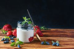 Useful berries to prepare deto. X, the story is on a wooden table Stock Photography