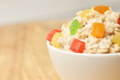 Useful breakfast. Bright colors. Oatmeal with dried fruits. Blurred background Royalty Free Stock Photography
