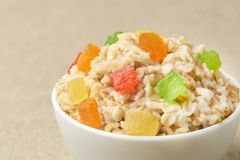 Useful breakfast. Bright colors. Oatmeal with dried fruits. Useful breakfast. Bright colors. Tasty oatmeal with dried fruits. Light background Royalty Free Stock Photos