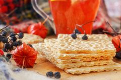 Useful breakfast with dietetic crackers and red tea with lemon. Wild berries, physalis. Wooden table Royalty Free Stock Images