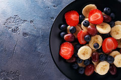 Useful breakfast of fruits and berries with space for text Stock Photography