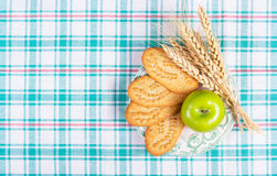 Useful breakfast, homemade cereal biscuits and a green apple. A useful snack. Stock Photography