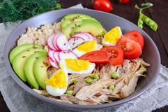 Useful breakfast: oatmeal with rabbit meat, avocado, boiled egg, tomatoes, radish Royalty Free Stock Photos
