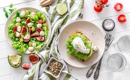 Useful breakfast. salad with figs, mozzarella, grapes Royalty Free Stock Photos