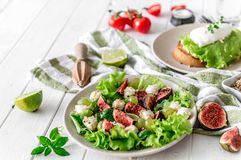 Useful breakfast. salad with figs, mozzarella, grapes Royalty Free Stock Images