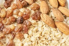 Useful breakfast. Oatmeal with almonds and raisins. Useful breakfast. Tasty oatmeal with almonds and raisins. Healthy food Stock Images