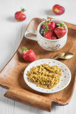 Useful breakfast on a tray, buckwheat porridge and ripe red stra Royalty Free Stock Photo