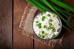 Useful cottage cheese with chives in a glass bowl Stock Image