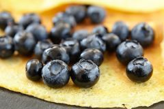 Useful delicacy made from organic products, pancakes with blueberries. Close-up of berries stock photos