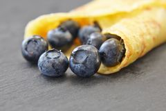 Useful delicacy made from organic products, pancakes with blueberries. Close-up of berries royalty free stock images