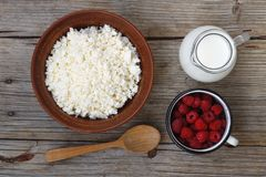 Useful dietary products. Cottage cheese, milk, raspberries. Wooden background Royalty Free Stock Image