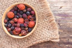 Free Useful Dried Berries In A Wooden Container Stock Photo - 110644270