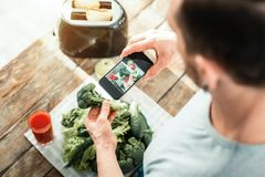 Useful ergonomic cellphone making photo. I will remember. Useful ergonomic cellphone making photo being above vegetables Stock Images