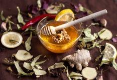 Useful foods to strengthen immunity -. Honey, hot peppers, lemon, linden herb, ginger, garlic Stock Images