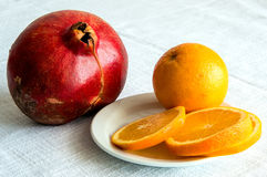 Useful fruits garnet and orange Royalty Free Stock Images