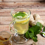 Useful ginger tea on the boards Royalty Free Stock Photos