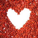 Useful goji berries. The decomposition on a white background heart of goji berries Royalty Free Stock Image
