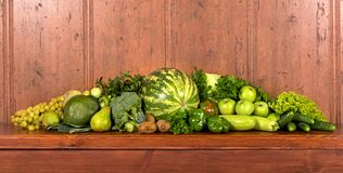 Green vegetables a wooden background Stock Photos