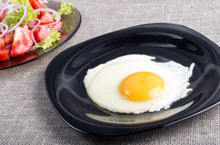 Useful homemade breakfast of fried egg and a salad Stock Images