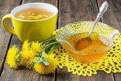 Useful jam of dandelions and flower tea royalty free stock image