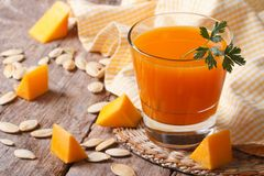 The useful juice of ripe pumpkin close-up on the table Royalty Free Stock Photography