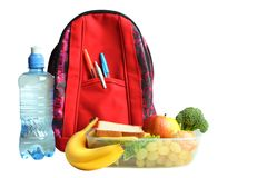 Useful food, lunch. A useful lunch in a container and a backpack isolated on a white background. Concept school lunch stock photo