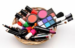 Useful makeup. Several useful makeup stacked next to each other in a wicker basket Stock Photos