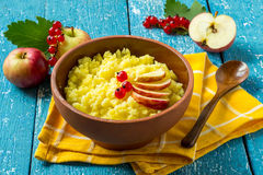 Useful millet porridge with apple and red currant Royalty Free Stock Photos