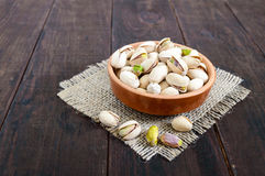 Useful nuts - pistachios in a ceramic bowl Stock Photos