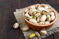 Useful nuts - pistachios in a ceramic bowl Stock Photo