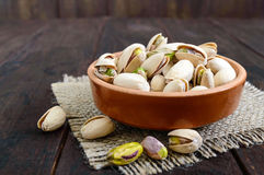 Useful nuts - pistachios in a ceramic bowl Stock Image