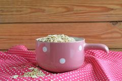 Useful oat flakes. On a pink napkin stock images