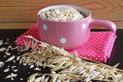 Useful oat flakes. On a pink napkin stock image